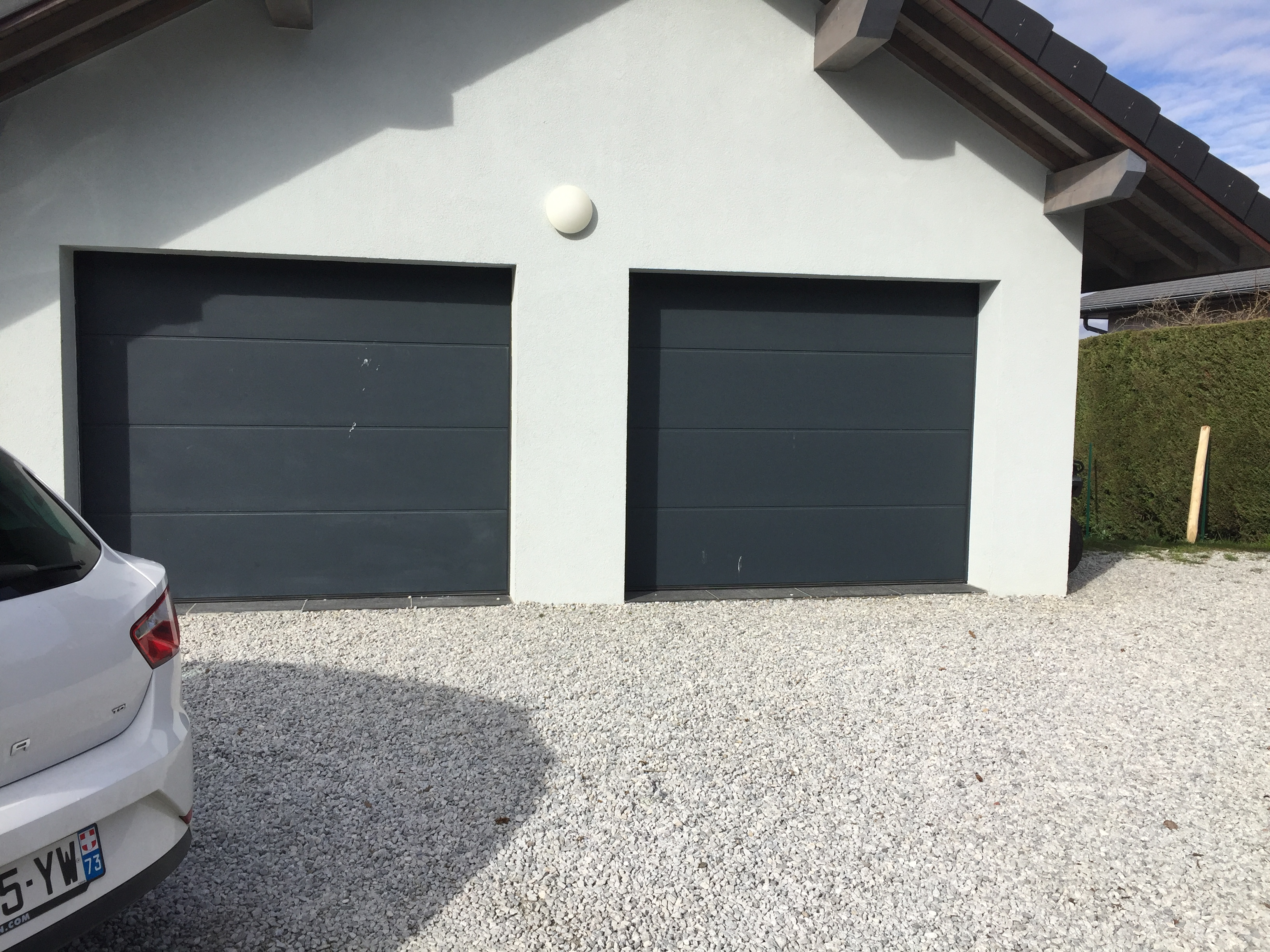 installation porte de garage sectionnelle